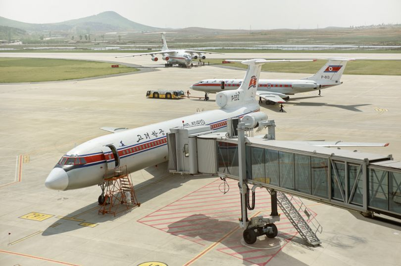 A Tarmac overview with Toplev-154, Tupolev-134 and a Ilyushin 76 transport plane at Sunan International Airport Pyongyang