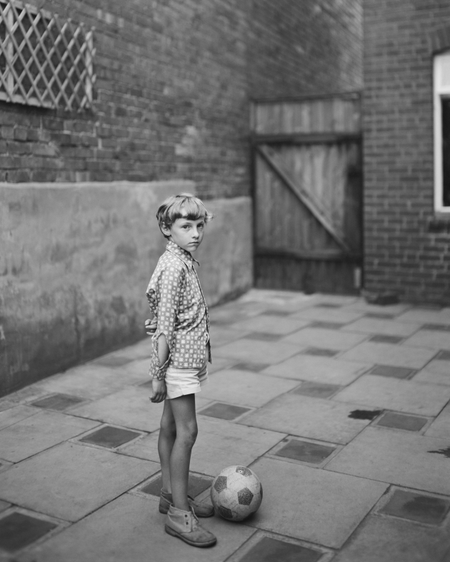 Young boy with ball, 1974 © John Myers courtesy RRB PhotoBooks