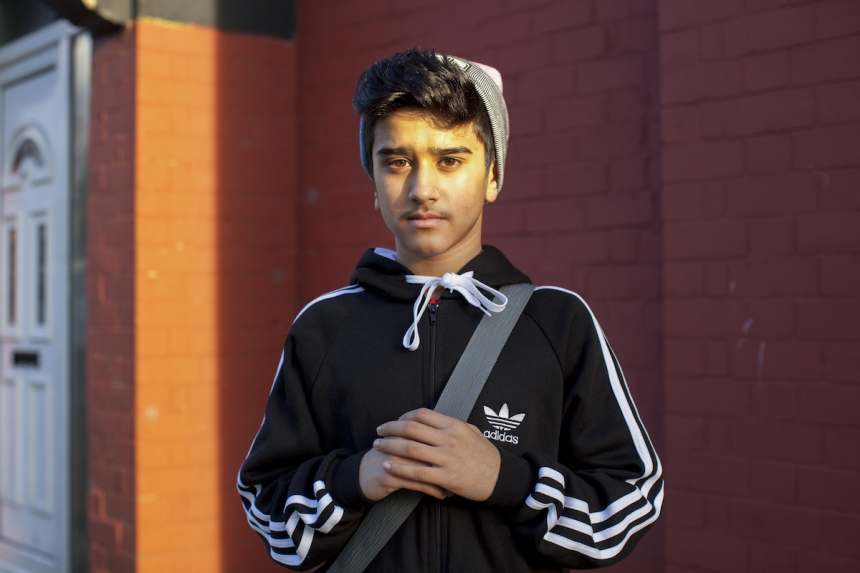 Mahtab Hussain Young boy in pink and grey beanie  from the series You Get Me? 2014 Courtesy of the artist