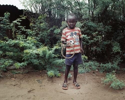 Mark Neville, 'Boy with Hoop in Kakuma Refugee Camp, Kenya', 2016, courtesy Mark Neville