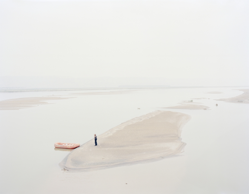 A man standing on an island in the middle of the river, Shaanxi, China, 2011 © Zhang Kechun