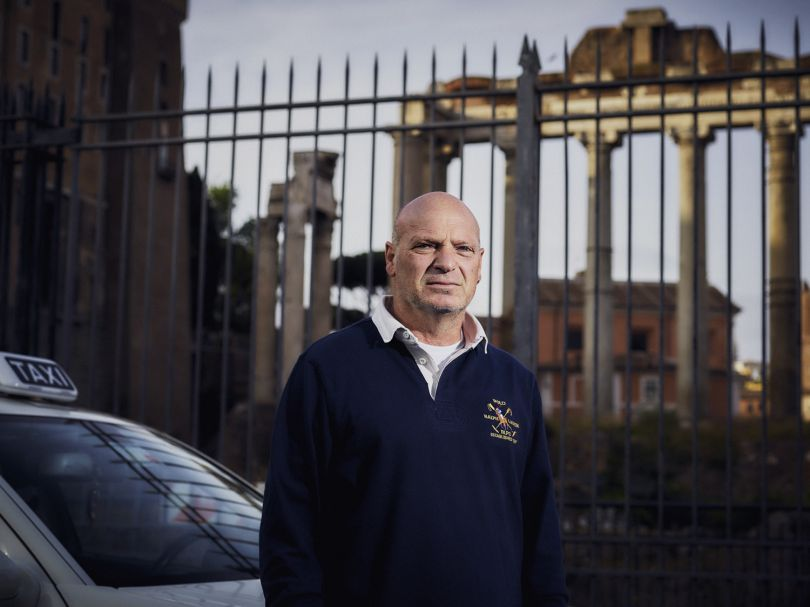 """""""No one owns me - I've been my own boss doing this for 34 years, free and independent. Uber don't have the right to work here - if I went to Florence with my licence as a driver from Rome, the taxi drivers in Florence are going to be really pissed at me! I would be stealing their jobs from under their noses. As a taxi driver from Rome I work here and pay my taxes here in Italy, Uber doesn't pay its taxes here and they don't even need a licence! We've fought them in court because they don't play by the rules but it's not progressing anywhere, it's completely unfair way of competing. We're not giving up though…"""" - Aldo, Rome. The Uber Impact © Matthew Joseph"""