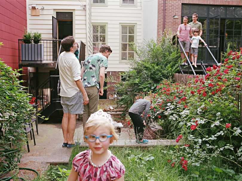 Glenn with his family talking to the neighbors. Brooklyn, New York © Bart Heynen from 'Dads' published by powerHouse Books