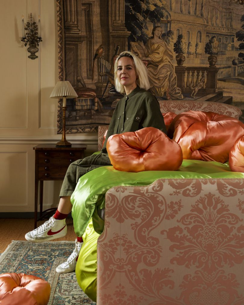 Designer Frith Kerr sitting on her seating installation at Fenton House. Photo credit: Oskar Proctor