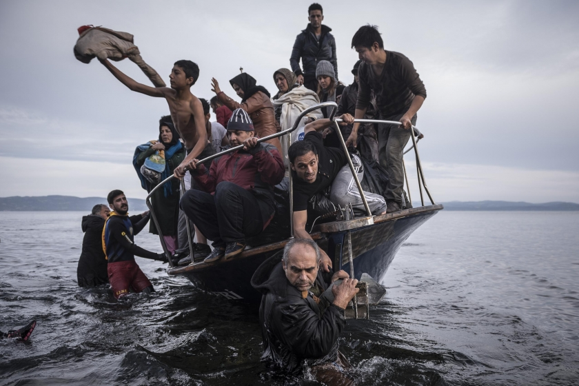 General News, first prize stories: Refugees arrive by boat near the village of Skala on Lesbos, Greece. Sergey Ponomarev.