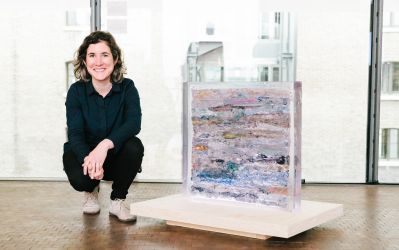 The artist pictured with the artwork 'Strata' - Low-density polyethylene cast in polyester resin, 65 x 65 x 10cm