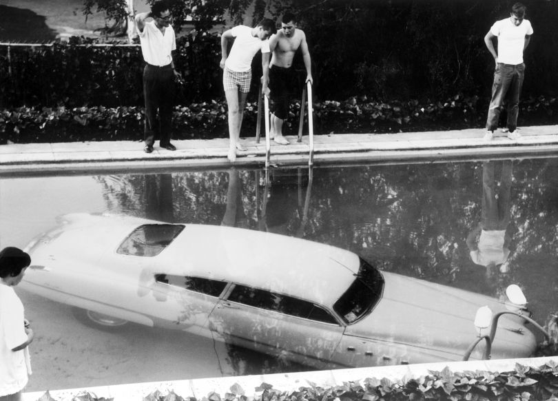 4th May 1961: A submerged car which its drunken owner 'parked' in a swimming pool in Beverly Hills, California, believing it to be a parking space. Nobody was injured in the process. (Photo by Keystone/Getty Images)