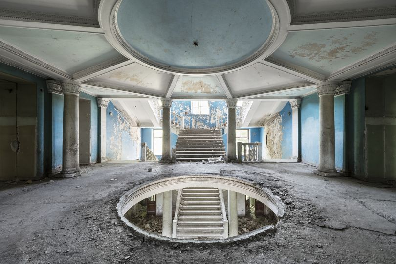 The view on the grand entrance hall inside a neglected sanatorium. This building will be redeveloped into a luxurious hotel. Tskaltubo, Georgia. © Reginald Van de Velde