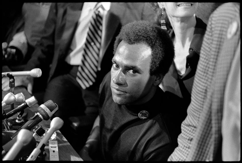 """Huey P. Newton Black Panther Party Minister of Defense, speaking to the media upon his release from prison on August 5th, 1970, at the offices of his attorney, Charles R. Garry. From, """"The Lost Negatives,"""" photographs by Jeffrey Henson Scales. Credit: Jeffrey Henson Scales"""