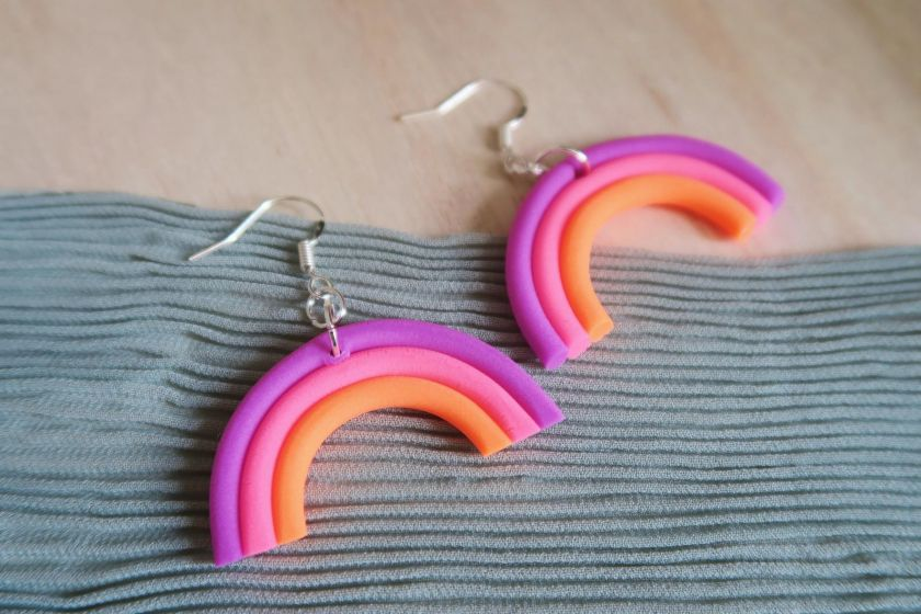 Purple Neon Rainbow earrings by [Rose Valley](https://www.etsy.com/uk/listing/828940854/purple-neon-rainbow-arch-dangle-earrings). Priced at £5.95