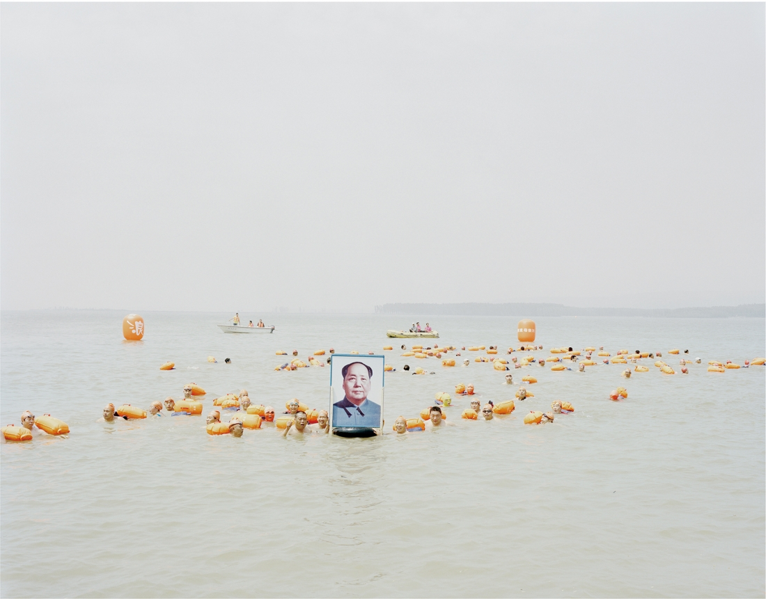People crossing the river with a photo of Mao Zedong, Henan, 2012 © Zhang Kechun