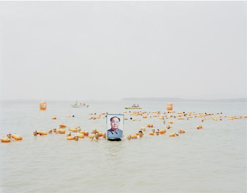 People crossing the river with a photo of Mao Zedong, Henan, 2012 © Zhang Kechun