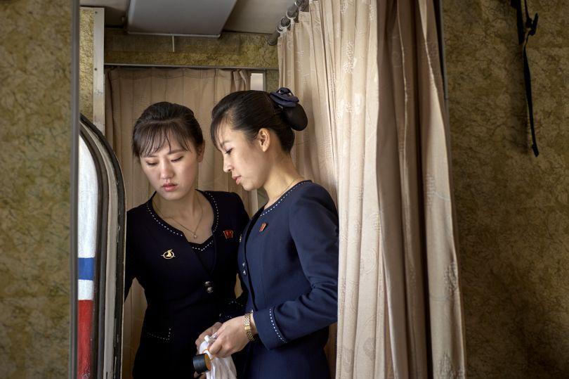 A senior stewardess explaining the door-handling