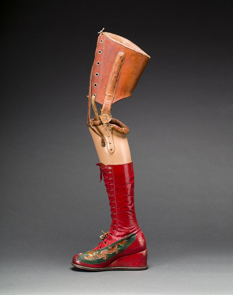 Prosthetic leg with leather boot. Appliquéd silk with embroidered Chinese motifs. Photograph Javier Hinojosa. Museo Frida Kahlo. © Diego Riviera and Frida Kahlo Archives, Banco de México, Fiduciary of the Trust of the Diego Riviera and Frida Kahlo Museums