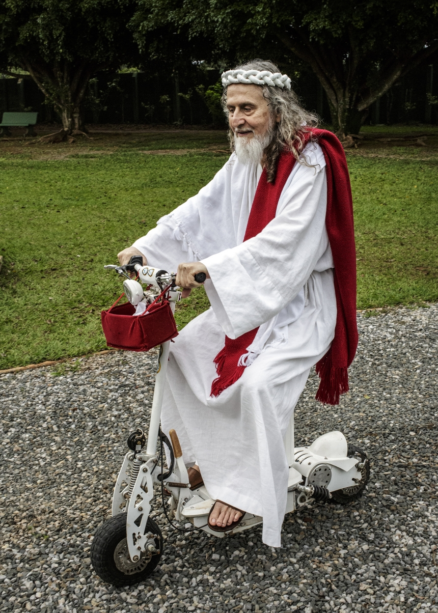 INRI Cristo, rides a bike around his compound outside of Brasilia, known as The New Jerusalem. INRI are the initials that Pontius Pilate had written on top of Jesus' cross. Brazil, 2014   © Jonas Bendiksen/ Magnum Photos