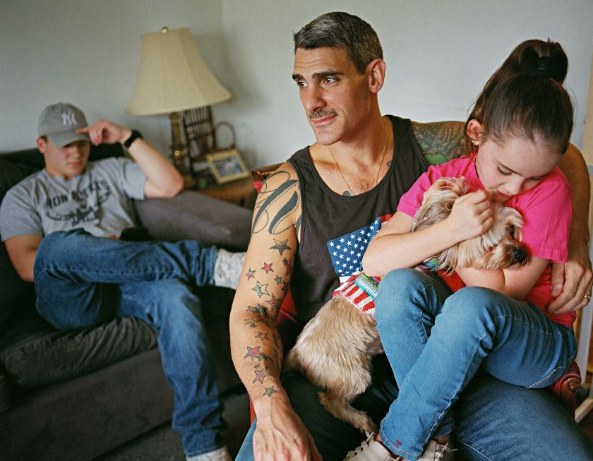 Johnny with his husband and children. Totowa, New Jersey © Bart Heynen from 'Dads' published by powerHouse Books