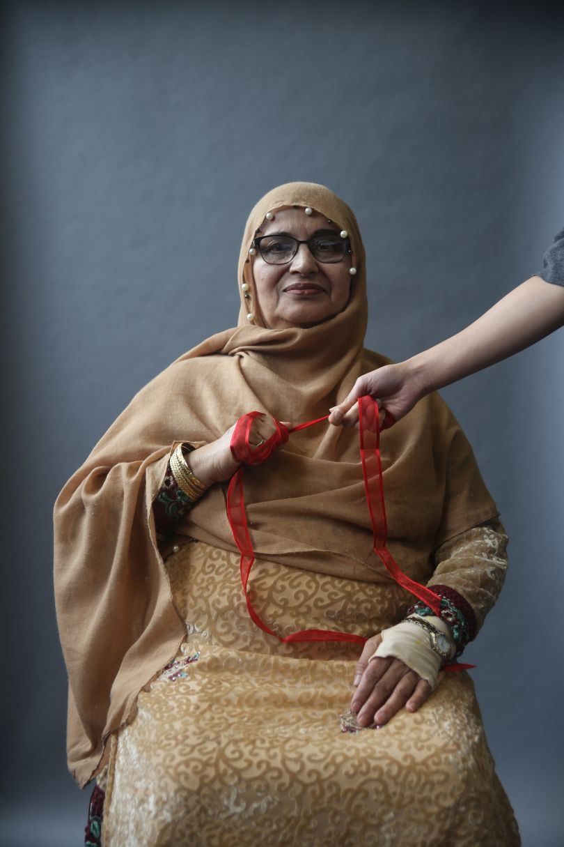 """Zahida Qateel Glasgow, 2018 Scarlett Crawford, 2018.  """"Zahida wanted to communicate her pride in family and community. She asked her daughter to hold the ribbon with her to represent this."""" © UK Parliament"""