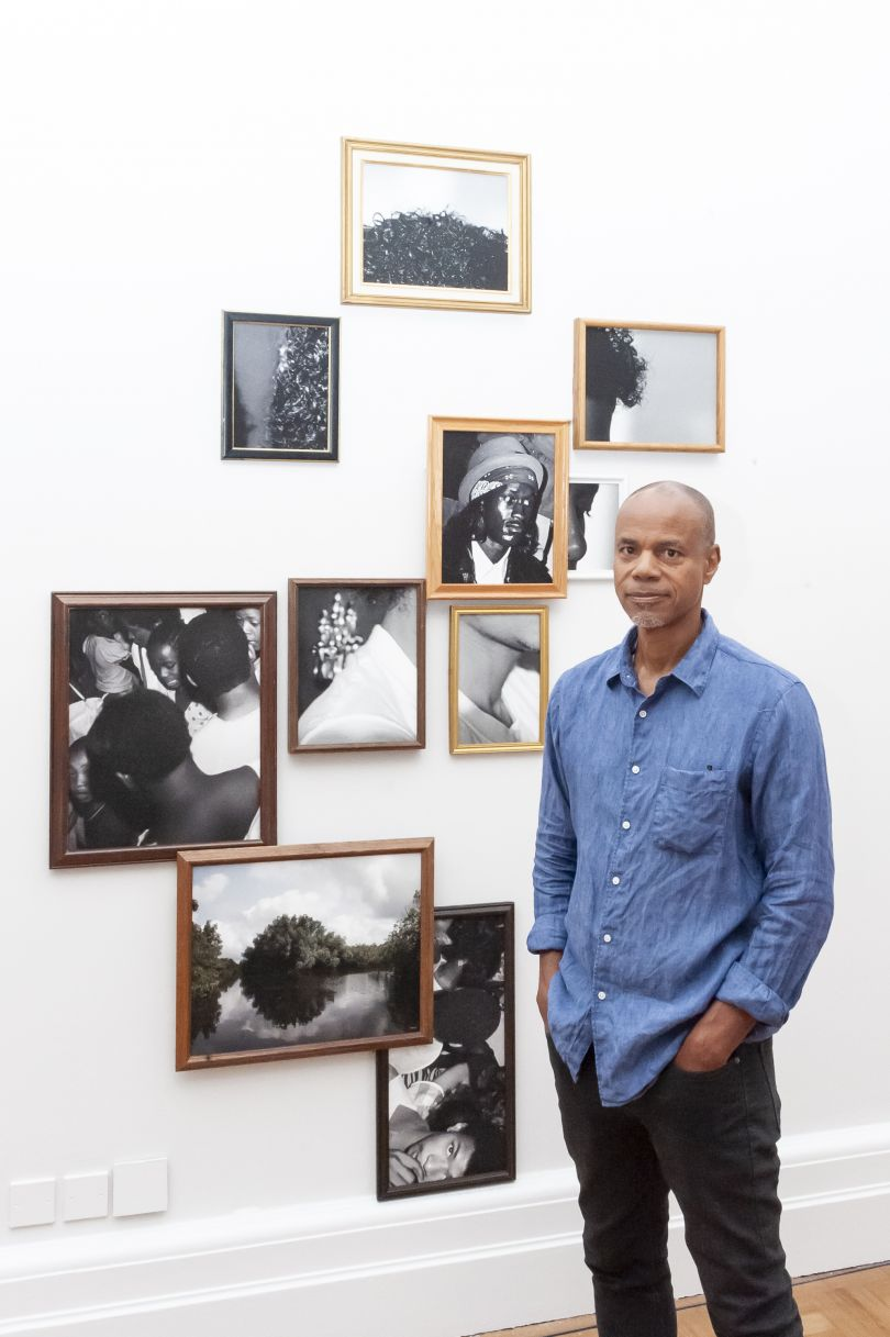 Todd Gray with his work, Exquisite Terribleness in the Mangroves 2014. Photograph by Jorge Herrera