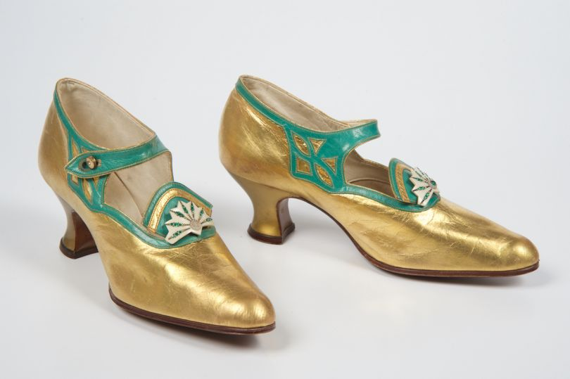 Co-operative Wholesale Society, Bar Shoes 1920-1925 Gold and green leather bar shoes, Northampton Museum and Art Gallery © courtesy of Northampton Museum and Art Gallery