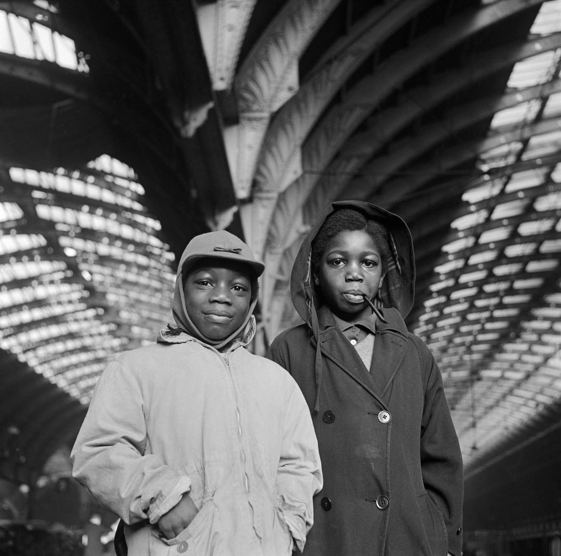 Boys at Paddington Train Station, Copyright Historic England