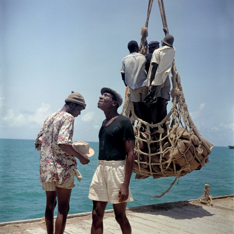 Togoland (Togo), 1958 – Loading people and goods at Lomé harbor © 2021 Todd Webb Archive