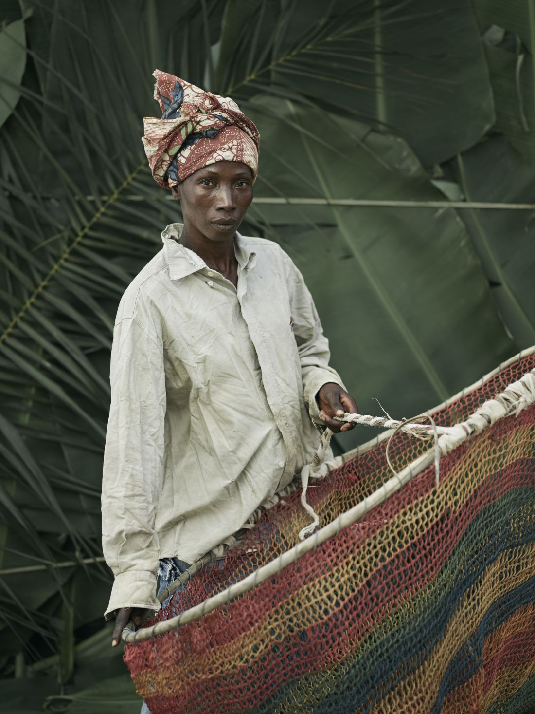 Massa Kennie, holding home-made hooped nets used for fishing, in the village of Tombohuaun, Kailahun District, Sierra Leone, May 2017. WaterAid/ Joey Lawrence