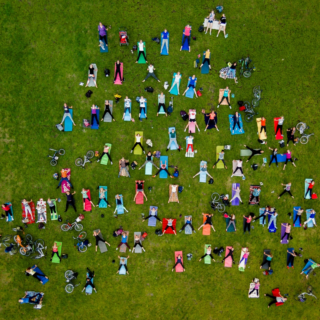 Open Air - Karolis Janulis: People on mass yoga exercise in the central park of Vilnius. (Open People)