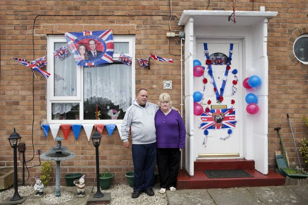 The Royal wedding between Kate Middleton and Prince William. Residents outside their home on Clare Road, Walsall, The Black Country, England, UK, 2011. From the series 'Black Country Stories'. © Martin Parr / Magnum Photos