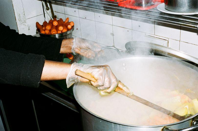 Cooking inside Zeret Kitchen © Jonas Martinez / Museum of London