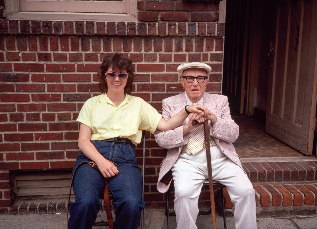 Mr Katz and Merly Sitting Outside His Apartment House, NY, May 1985 © Meryl Meisler