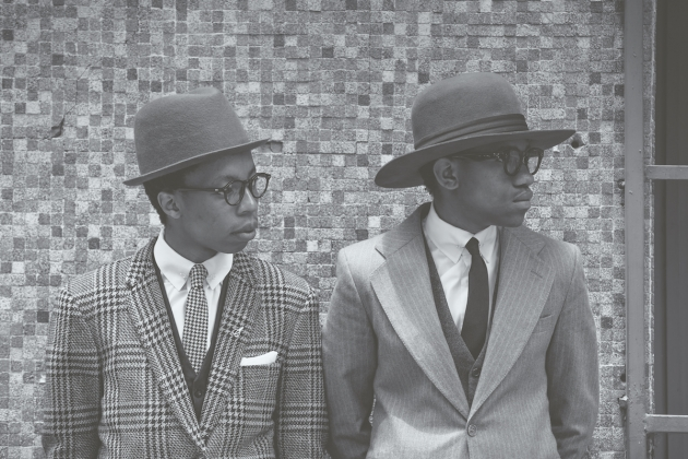 'Wanda and Kabelo, aka The Sartists, dressed to the nines, topped off with Simon and Mary bespoke hats and classic eyewear, Johannesburg, 2014.'  	© Aimee Pozniak; art direction by Jana & Koos