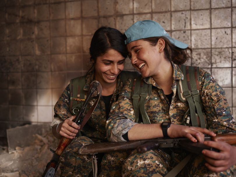 Silava and Berivan share a laugh in an abandoned ISIS base. Shengal, Nineveh Governorate, Iraq, November 23, 2015. From [We Came From Fire](https://amzn.to/2L9l8Vm) by Joey L. – published by powerHouse Books