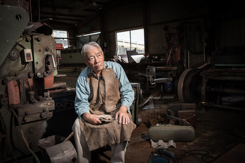 Katsuyuki Yashima sitting in his own workshop, which employed 15 people before the disaster