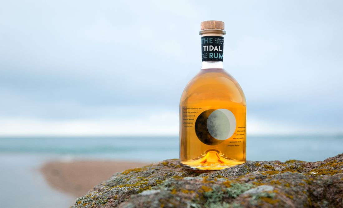 """Lewis Moberly designs a bottle """"kissed by the tide"""" for Tidal Rum"""