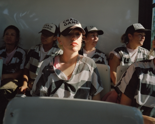 Female inmates on the bus at dawn