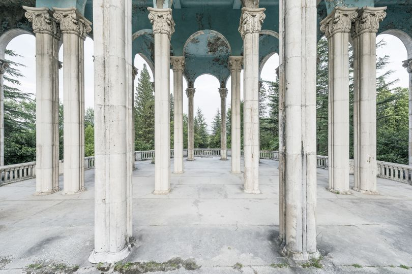 Monumental arches adorn this open-air-treatment gallery inside a former sanatorium. Tskaltubo, Georgia. © Reginald Van de Velde