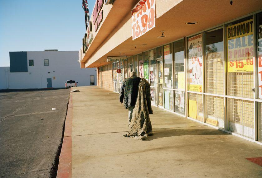 Bobby dragging his blanket to untangle the energy fields. Homeless for 13 years. Las Vegas, Nevada 2016 © Thilde Jensen