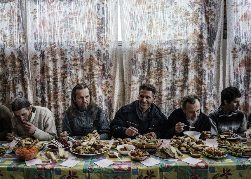 Communal feast during an all-day pilgrimage march for Vissarion's birthday on January 14th. This date is known as the true Christmas to his followers. Russia, 2015   © Jonas Bendiksen/ Magnum Photos