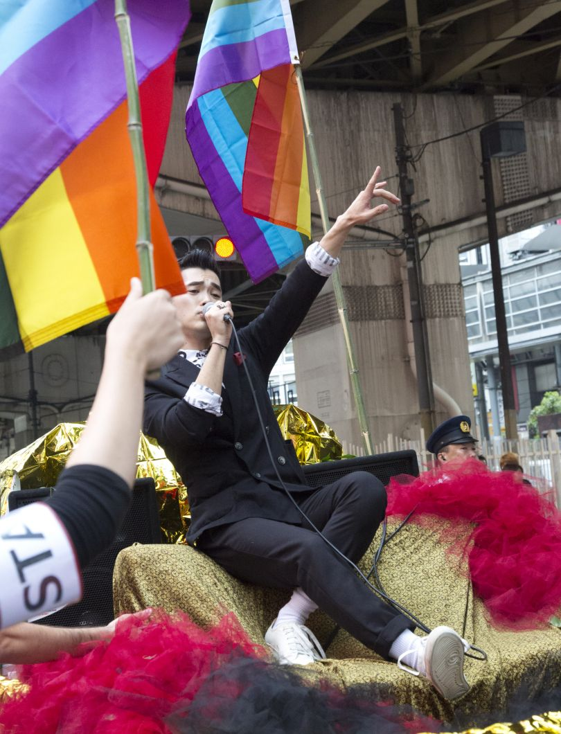 Shingo from Apotheke singing from the lead float at the Kansai Rainbow Parade, Copyright © 2017  by Michel Delsol, originally  appeared in Edges of the Rainbow: LGBTQ Japan, published by The New Press.