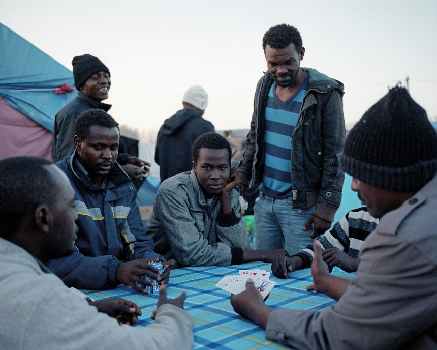 Calais, France, November 2015 Sudanese men playing cards