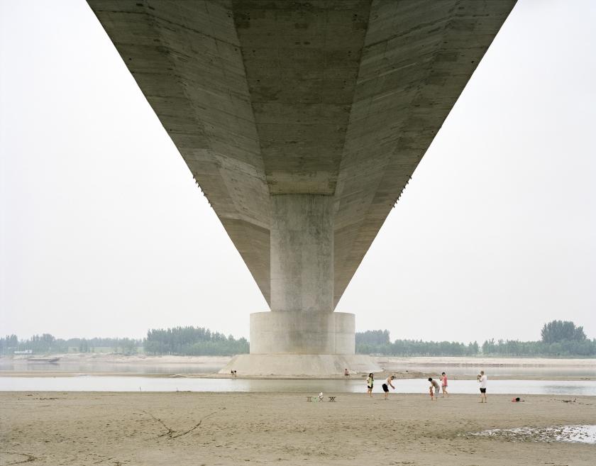 A family spending a weekend under a bridge, Shandong, China, 2011 © Zhang Kechun