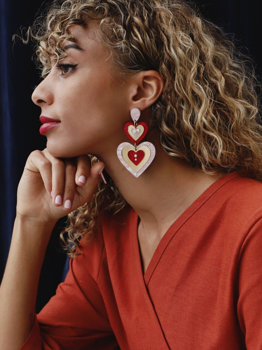 Ava statement earrings by [Wolf & Moon](https://www.wolfandmoon.com/collections/reverie/products/ava-statement-earrings-in-red-pink-limited-edition). Priced at £85