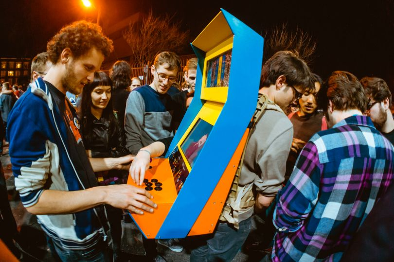 Resembling a miniature replica of an arcade machine, the Arcade Backpack was created to show a rotating selection of independent and experimental videogames in surprising settings. Credit: UCLA Games Lab (Photo by Robin Baumgarten)