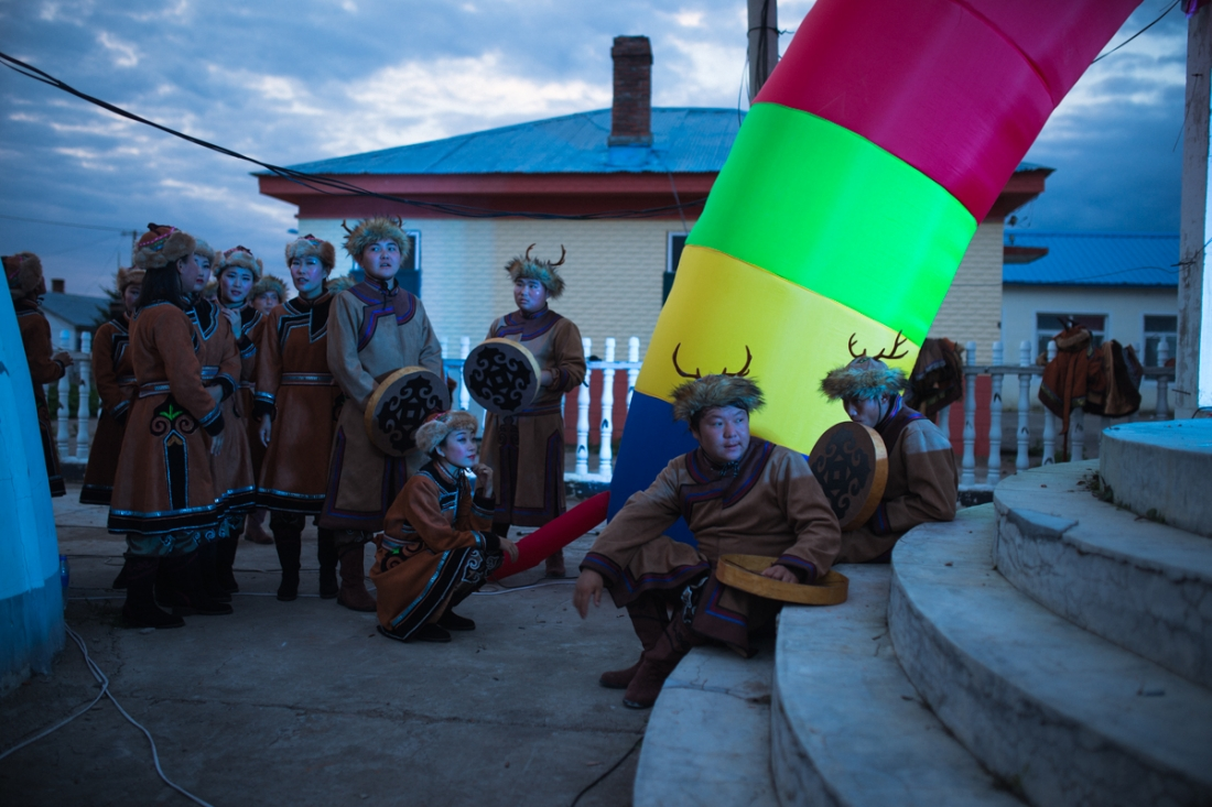 Xin'e Oroqen Settlement, August 2017 Performers plucked from the local youth wait to perform at the annual Fire Festival. Whilst Xin'e is designated an Oroqen settlement, the ethnic diversity of the region is reflected in the backgrounds of the performers, many of whom are Oroqen, Ewenki or Mongolian or have one parent from the Han majority population following increasing levels of intermarriage throughout the 20th and 21st centuries.