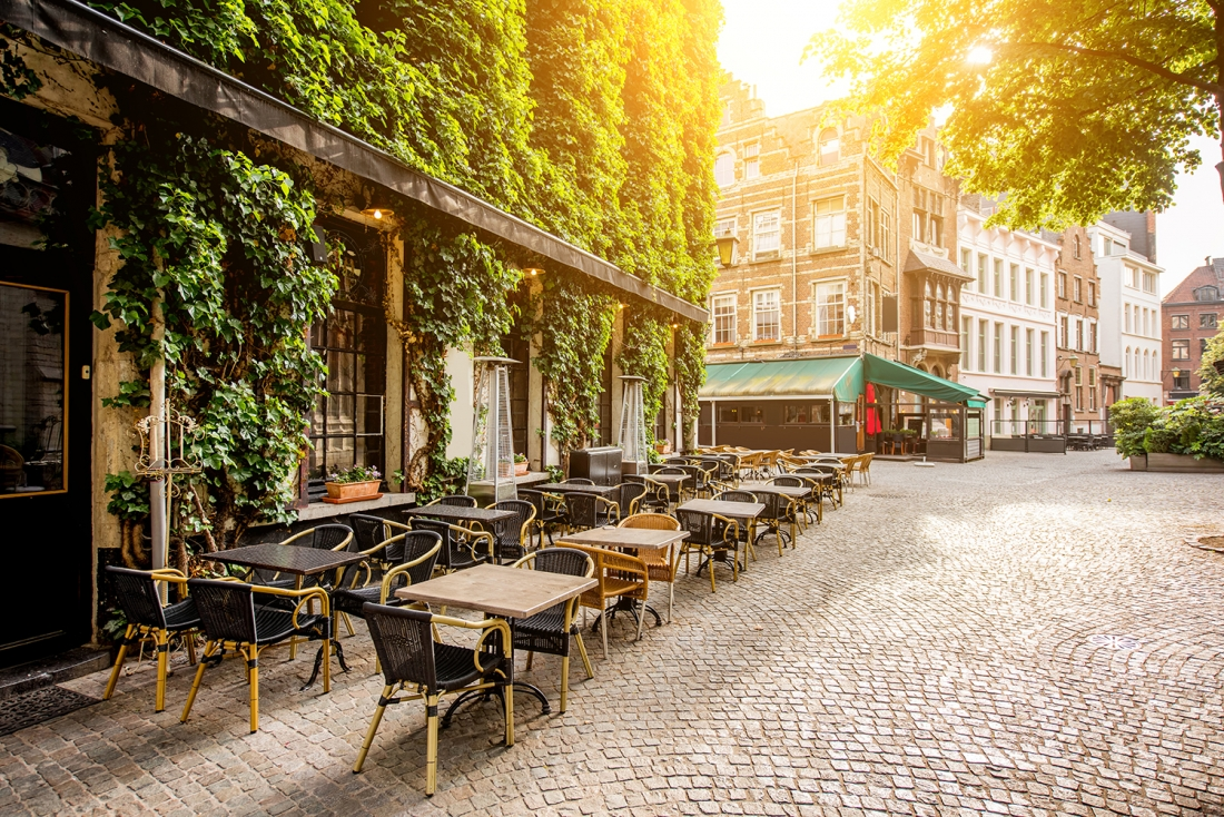 Street view with cafe terrace during the morning in Antwerpen city in Belgium, Adobe Stock