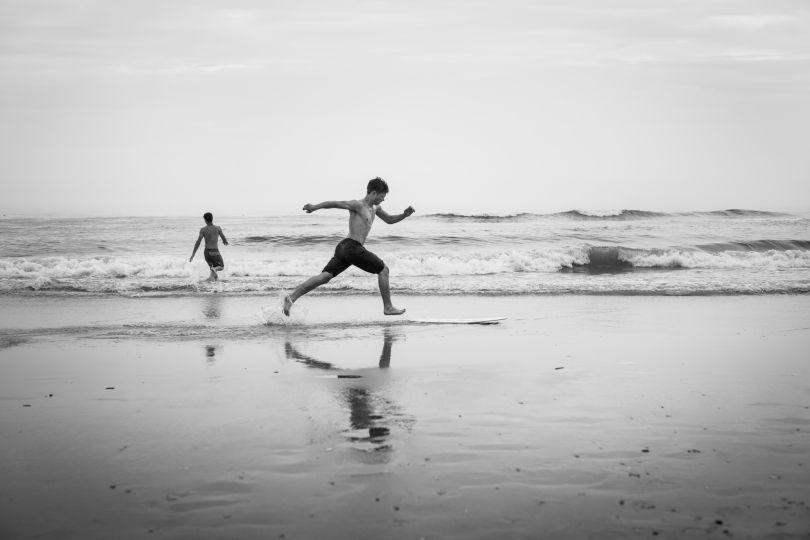 Zane Rockwell of suburban Philadelphia skimboards in the shallow surf. June 2018. © Timothy Roberts