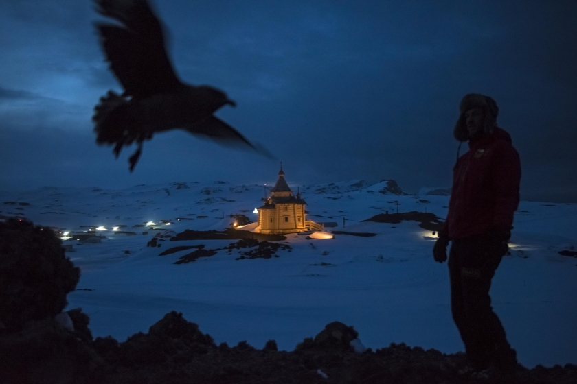 Daily Life, first prize stories: A Chilean scientist walks above the Russian Orthodox Church of the Holy Trinity on the Bellingshausen Russian Antarctic base. Daniel Berehulak.