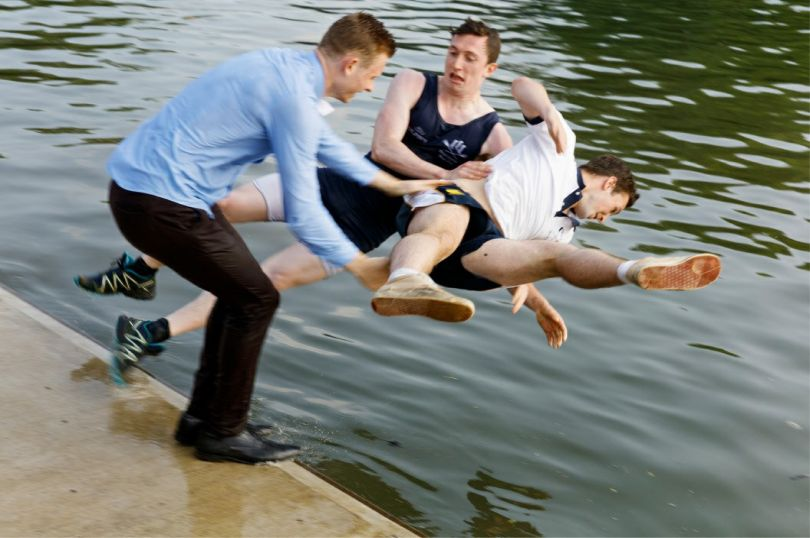 After the Summer Eights competition the winning team and often other college rowers are thrown into the river. Oriel College rowers, 2016 © Martin Parr / Magnum Photos / Blindspot Gallery