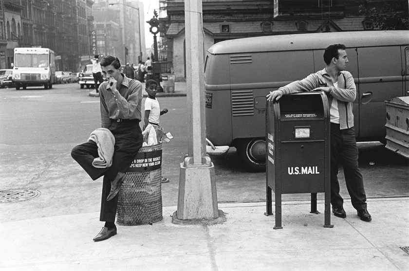 Two young men waiting at the corner, 1965