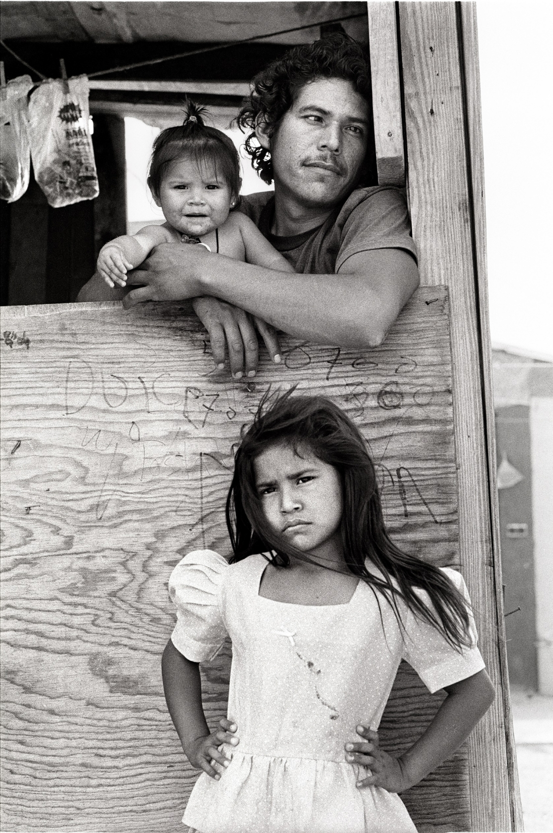 Laura Wilson, Child with Father and Sister, Colonia, Nuevo Laredo Mexico, April 19, 1993